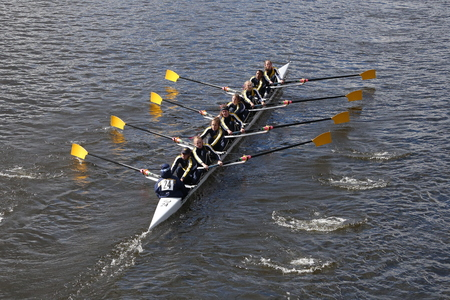eights: BOSTON - OCTOBER 18, 2015: Cresent Rowing races in the Head of Charles Regatta Womens Youth Eights Editorial