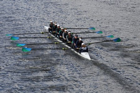 sculling: BOSTON - OCTOBER 18, 2015: New Trier Rowing Club races in the Head of Charles Regatta Womens Youth Eights Editorial