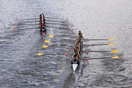 sculling: BOSTON - OCTOBER 18, 2015: CRI left and Merion Mercy right races in the Head of Charles Regatta Womens Youth Eights Editorial