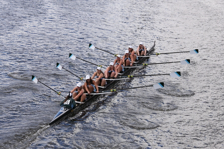 eights: BOSTON - OCTOBER 18, 2015: Green Lake races in the Head of Charles Regatta Womens Youth Eights Editorial