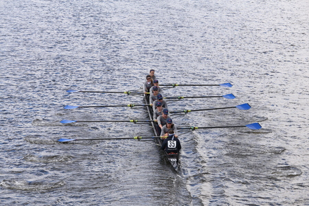 sculling: BOSTON - OCTOBER 18, 2015: PNRA Mercer Rowing races in the Head of Charles Regatta Womens Youth Eights