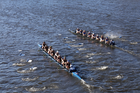 BOSTON - OCTOBER 23, 2016: Grand Valley(left) Colby College (right) races in the Head of Charles Regatta Womens Collegiate Eights