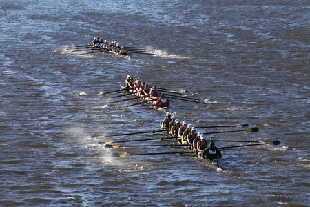 BOSTON - OCTOBER 23, 2016: Vermont (bottom) WPI (middle) Geaorgie Tech (top) races in the Head of Charles Regatta Womens Collegiate Eights