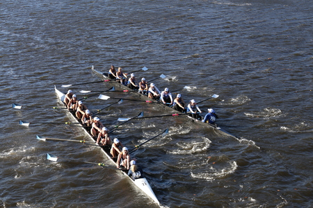 BOSTON - OCTOBER 23, 2016: SUNY Geneseo (left) JWU Rowing (right) races in the Head of Charles Regatta Womens Collegiate Eights Editorial