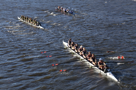 BOSTON - OCTOBER 23, 2016: Colorado (left) JWU Rowing (right) Illinois(bottom)  races in the Head of Charles Regatta Womens Collegiate Eights [PUBLIC RACE] Editorial