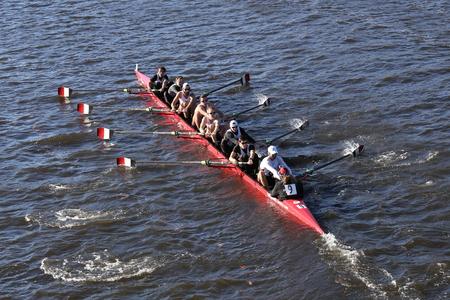 BOSTON - OCTOBER 18, 2015: Univ of Cincinnati races in the Head of Charles Regatta Mens Master Eights Editorial