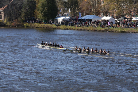 BOSTON - OCTOBER 18, 2015: Michigan (right) and Wesleyan (left) races in the Head of Charles Regatta Mens Master Eights Editorial