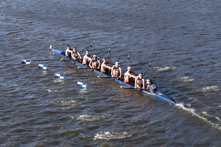 eights: BOSTON - OCTOBER 22, 2016: Connecticut University races in the Head of Charles Regatta Mens College Eights Editorial