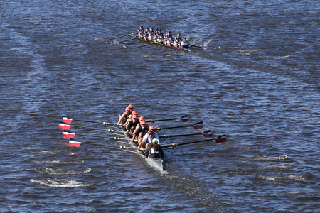 eights: BOSTON - OCTOBER 23, 2016: Ra-Rye (bottom) mercer (top)  races in the Head of Charles Regatta Mens Youth Eights [PUBLIC RACE] Editorial