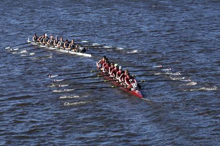 BOSTON - OCTOBER 23, 2016: Green Lake (top)  Arlington Belmont Crew (bottom) Crew races in the Head of Charles Regatta Mens Youth Eights