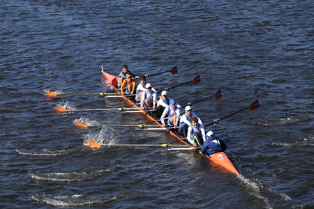 BOSTON - OCTOBER 23, 2016: OKC Riversport Crew races in the Head of Charles Regatta Mens Youth Eights Editorial