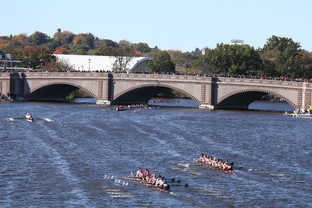 eights: BOSTON - OCTOBER 23, 2016: Boston College HS (Bottom) and Fordham (top) race for the bridge in the Head of Charles Regatta Mens Youth Eights