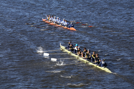 BOSTON - OCTOBER 23, 2016: Dallas United (bottom) OKC Riversport (top) Crew races in the Head of Charles Regatta Mens Youth Eights