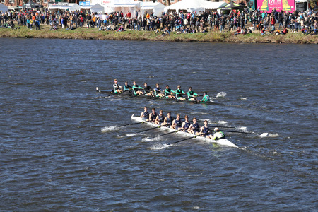 BOSTON - OCTOBER 23, 2016: Wilson High School (top) Greater Lawrence Rowing(bottom)  Crew races in the Head of Charles Regatta Men's Youth Eights