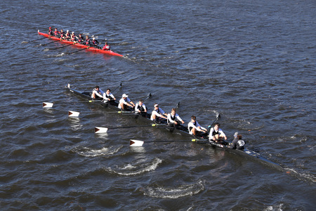 BOSTON - OCTOBER 23, 2016: Stonington (bottom) Shaker Heights (top) Crew races in the Head of Charles Regatta Mens Youth Eights Editorial