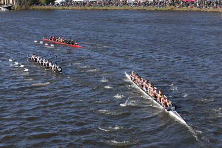 BOSTON - OCTOBER 23, 2016: Stonington (left) Shaker Heights (middle) St andrews (right) Crew races in the Head of Charles Regatta Mens Youth Eights Editorial