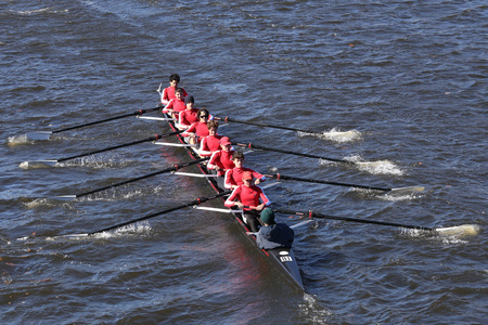 BOSTON - OCTOBER 23, 2016: Neponset Rowing Club  Crew races in the Head of Charles Regatta Mens Youth Eights Editorial