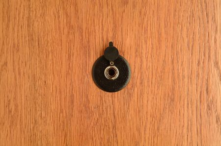 The spyhole on wooden doors Stock Photo - 6265478