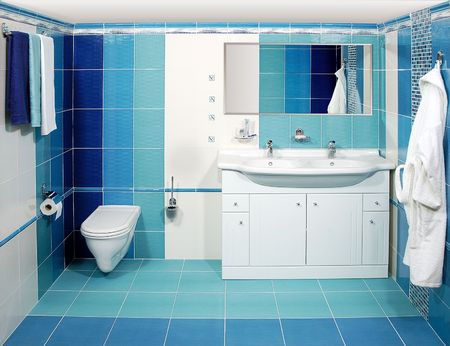 The luxury bathroom in blue with the bathrobe Imagens