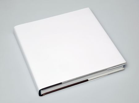 cover: A blank book in angle on white paper 2