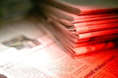 A detail of a pile of newspaper in red light Stock Photo - 6280993
