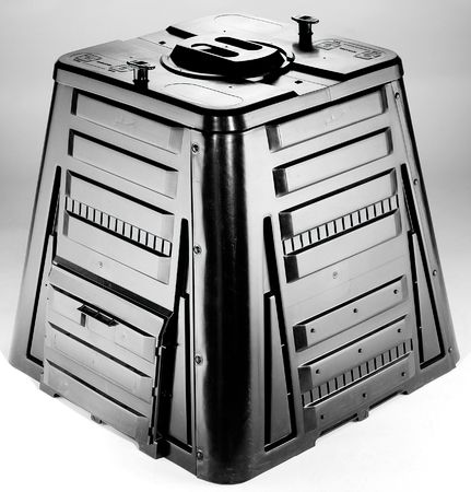 composting: Black plastic shiny garden composter made from three pieces