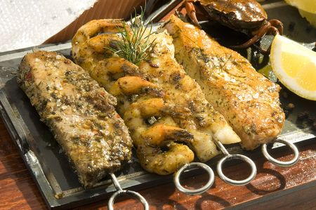 pikeperch: Various kind of grilled fish and seafood mexican style Stock Photo