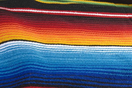Colorful mexican poncho close up texture photo