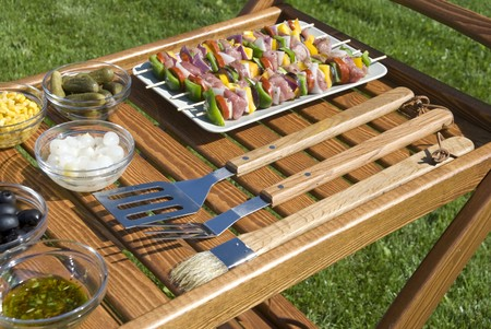 The barbecue set w the meat on the spits Stock Photo