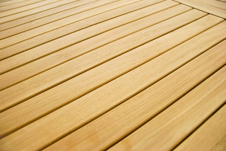 A wooden garden table in a detail Stock Photo