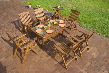furniture: The Garden furniture at the patio w place setting