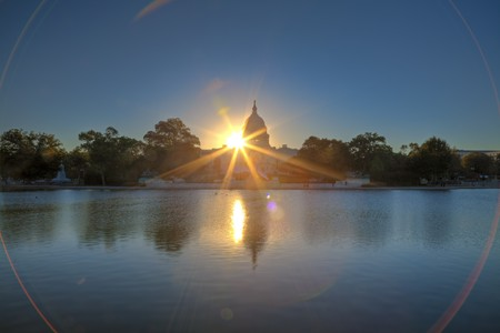 U.S. Capitol at sunrise mirroring in the water photo