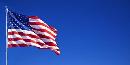 american flag waving: American flag waving in blue sky