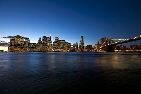 The New York City skyline at twilight w Brooklyn Bridge photo