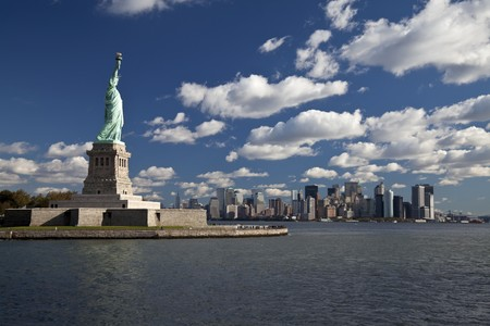 The Statue of Liberty and New York City Downtown photo