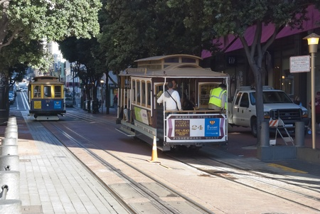 SAN FRANCISCO - NOVEMBER 2008: The Cable car tram, November 7th, 2008 in San Francisco, USA. The San Francisco cable car system is world last permanently manually operated cable car system. Stock Photo - 9890789