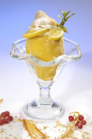 Frozen lemon filled by lemon sorbet w mint leave