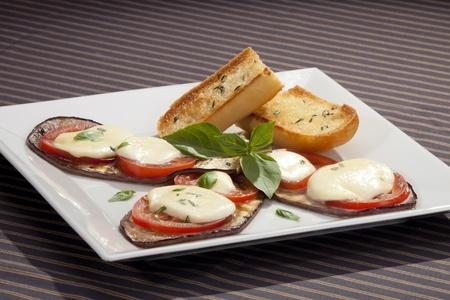 greek food: Baked aubergine w tomatoes and mozzarella