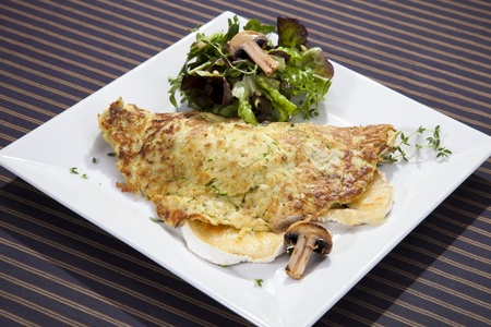Potato pancake filled by grilled camembert and mushrooms