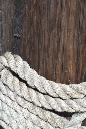 rigging: The hawser on the wooden post Stock Photo