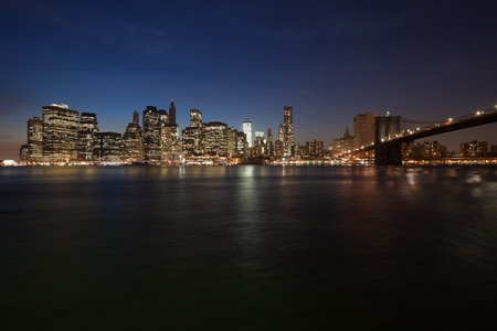 The New York City skyline at twilight w Brooklyn Bridge photo