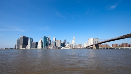 The New York City skyline at afternoon w the Freedom tower and Brooklyn bridge photo