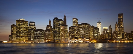 The New York City skyline at twilight w the Freedom tower