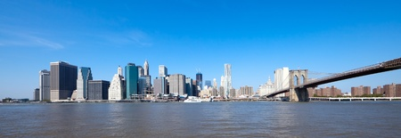 The New York City skyline at afternoon w the Freedom tower and Brooklyn bridge Stock Photo - 13493431
