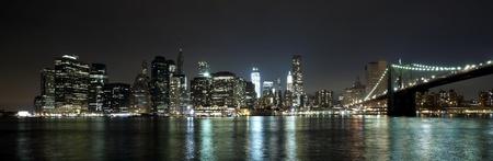 new york at night: The New York City skyline at night w Brooklyn Bridge and Freedom tower Stock Photo