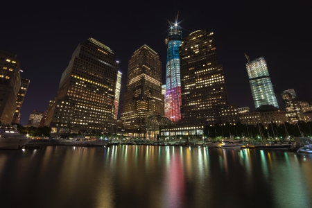 on cloud nine: NEW YORK CITY - SEPTEMBER 17: One World Trade Center (known as the Freedom Tower) is shown under new  illumination on September 17, 2012 in New York, New York. Editorial