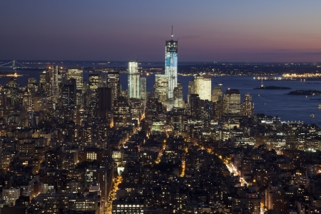 city line: The New York City skyline at twilight w the Freedom tower