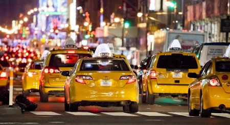 NEW YORK CITY - SEPT 22: Eight Avenue, featured with Taxi Cabs, Shops and animated LED signs, is a symbol of New York City and the United States, September 22, 2012 in Manhattan, New York City