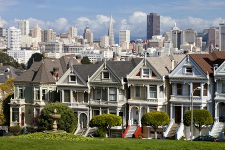 Painted Ladies with San Francisco skyline in the background as seen from Alamo Square.