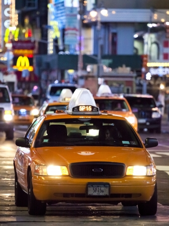 yellow cab: NEW YORK CITY - SEPT 17: Times Square, featured with Broadway Theaters, Taxi Cabs and animated LED signs, is a symbol of New York City and the United States, September 17, 2012 in Manhattan, New York City